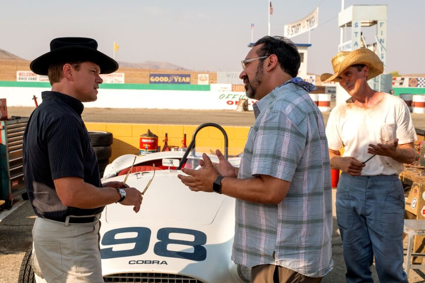 "Matt Damon and Christian Bale with direcor James Mangold on the ""Ford v Ferrari"" set."