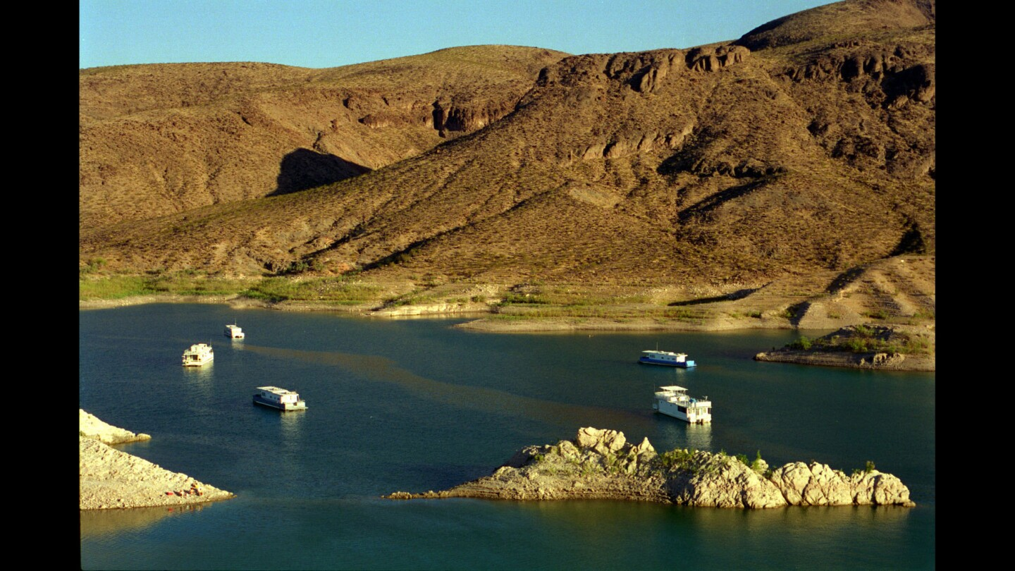 Houseboats dock at the Echo Bay Marina in Lake Mead in 1994, before the start of a 15-year drop in the lake's water level.