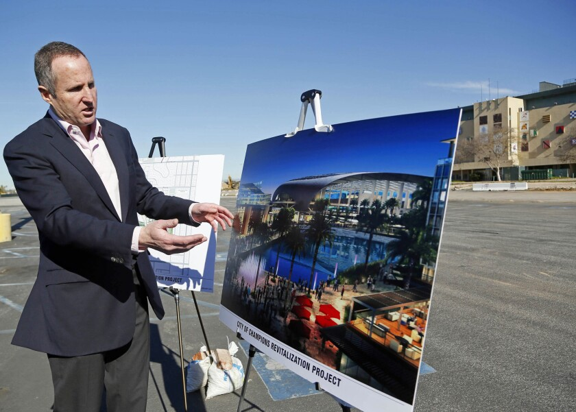 Chris Meany, senior vice president of Hollywood Park Land Company, shows an artist's rendering of a proposed NFL stadium at Hollywood Park in Inglewood.