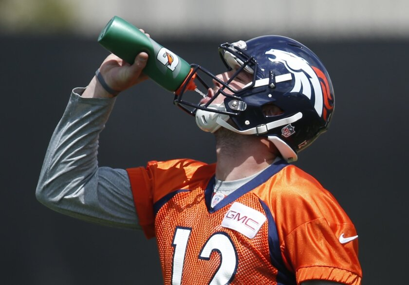 Denver Broncos rookie quarterback Paxton Lynch takes a drink during NFL football practice Tuesday, May 31, 2016, at the team's headquarters in Englewood, Colo. (AP Photo/David Zalubowski)