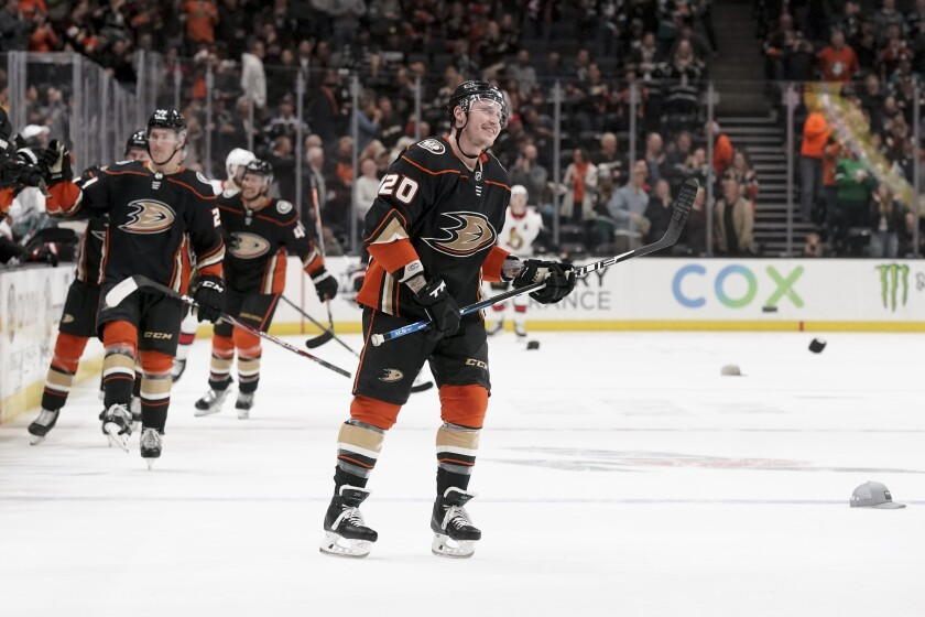 Ducks left wing Nicolas Deslauriers celebrates after a hat trick against the Ottawa Senators during the first period at Honda Center on Tuesday.