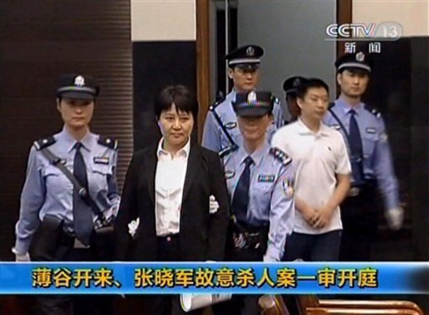 This video image taken from CCTV shows Gu Kailai, second left, the wife of disgraced politician Bo Xilai, being taken into the Intermediate People's Court in the eastern Chinese city of Hefei Thursday Aug. 9, 2012. According to testimony Thursday in one of China's highest-profile murder trials in years, Gu lured British businessman Neil Heywood to a hotel in the southwestern mega-city of Chongqing, where she got him drunk and fed him poison. The secretive trial of Gu and a household aide, who are accused of murdering Bo family associate Heywood, ended in less than a day at the court. (AP Photo/CCTV via APTN) CHINA OUT