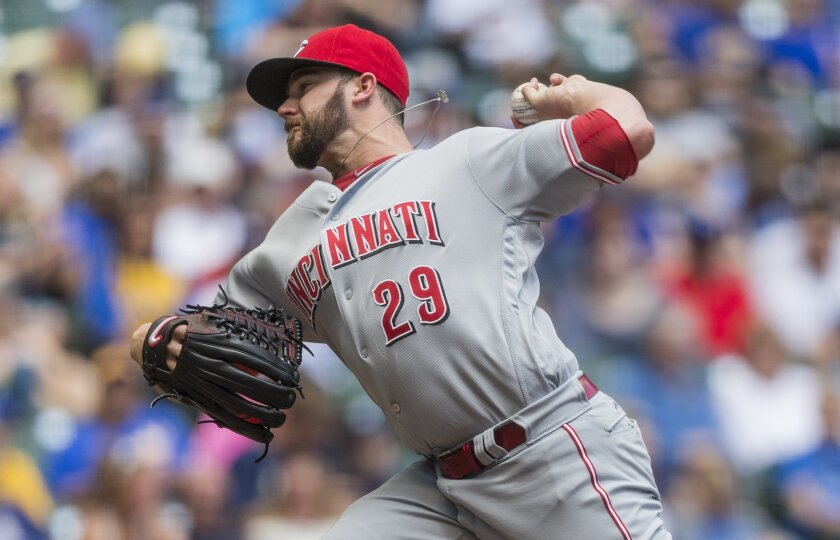 Cincinnati Reds' Brandon Finnegan pitches to a Milwaukee Brewers batter during the first inning of a baseball game Sunday, May 29, 2016, in Milwaukee. (AP Photo/Tom Lynn)