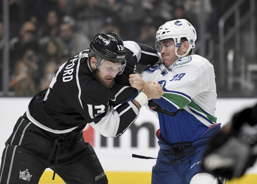 Kings left wing Kyle Clifford and Canucks left wing Micheal Ferland fight during a game at Staples Center.