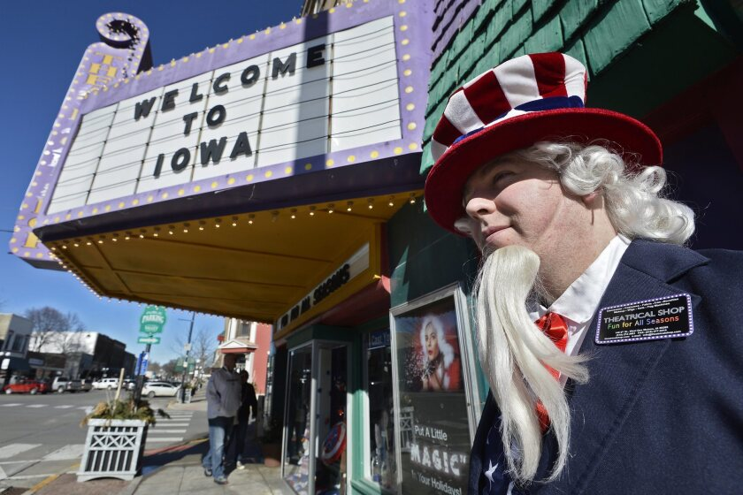 A man dressed as Uncle Sam walks near a costume shop in West Des Moines on Sunday, a day before the Iowa caucuses, which became an embarrassing failure for the Iowa Democratic Party.