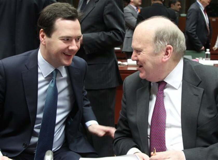 British Chancellor of the Exchequer George Osborne, left, talks with President of the EU rotating Council and Irish Finance Minister Michael Noonan during the EU finance ministers meeting, at the European Council building in Brussels, Tuesday, Feb. 12, 2013. Irish Finance Minister Michael Noonan ha