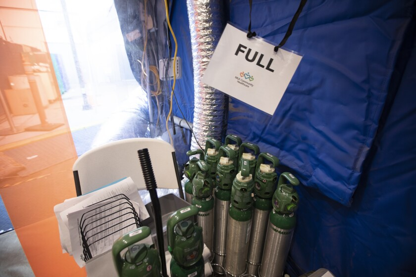 Oxygen tanks are stored in a tent outside Martin Luther King Jr. Community Hospital.
