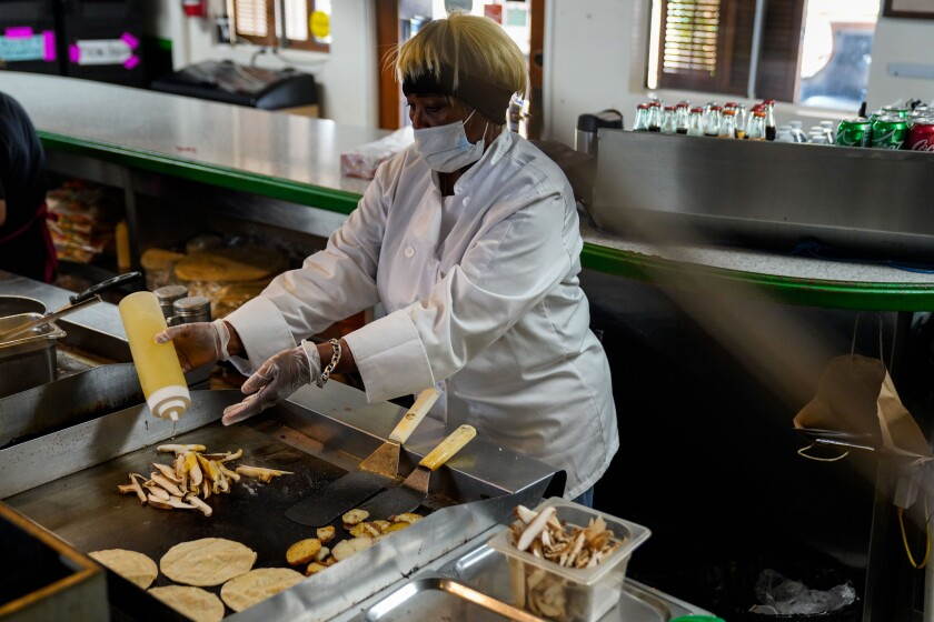 Barbara Burrell in the kitchen, prepares tacos at her restaurant Sky's Gourmet Tacos.