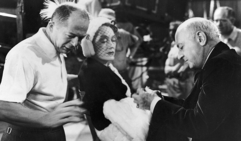 "Billy Wilder, left, Gloria Swanson and Cecil B. DeMille on the set of ""Sunset Boulevard."""