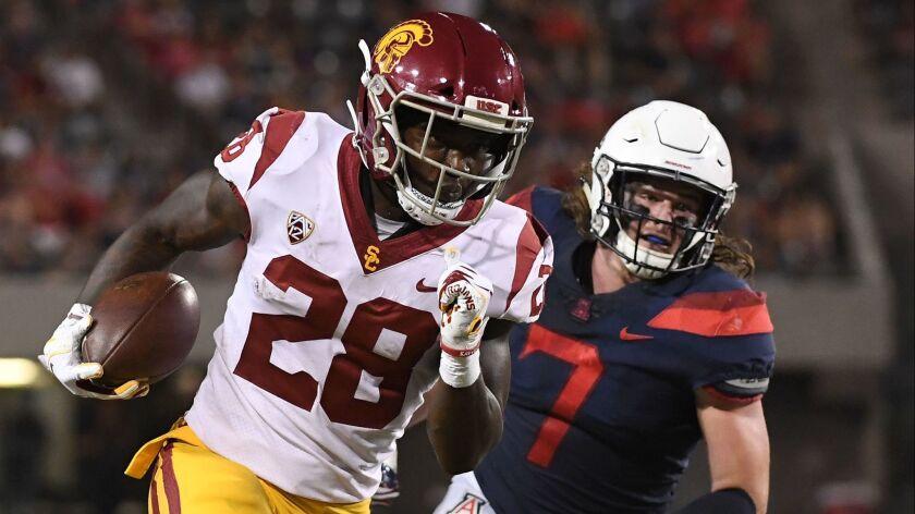 USC running back Aca'Cedric Ware runs the football 26 yards to score a touchdown against Arizona at Arizona Stadium on Saturday in Tucson, Ariz.