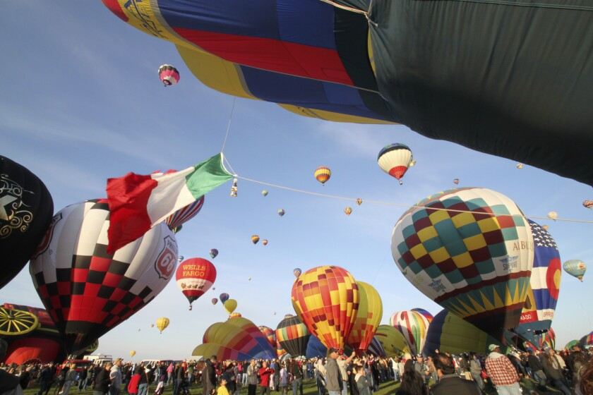 FILE - In this Oct. 2, 2011, file photo, thousands of spectators mingle among inflating hot air balloons at the 40th Albuquerque International Balloon Fiesta in Albuquerque, N.M. Hundreds of hot air balloons will lift off from the New Mexico desert over nine days, scheduled to begin on Saturday, Oct. 5, 2019, as part of one of the world's largest festivals dedicated to the sport of ballooning. (AP Photo/Susan Montoya Bryan, File)