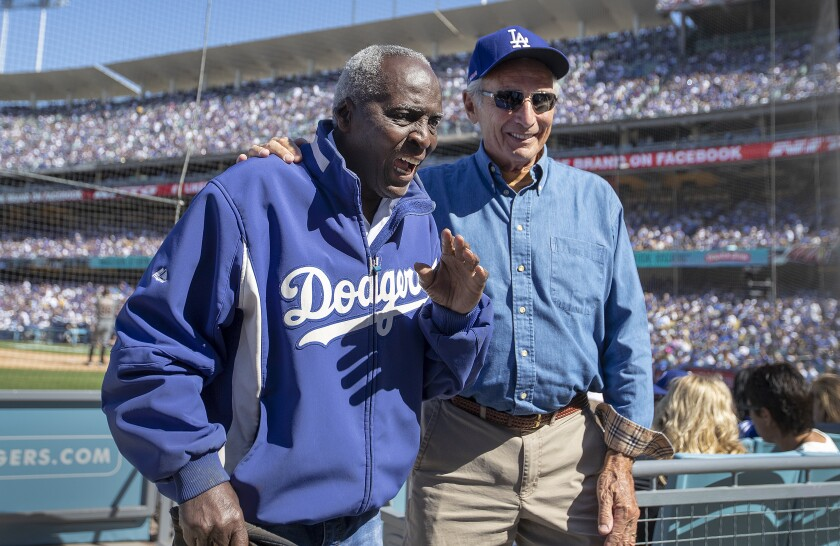 Former Dodgers outfielder Lou Johnson, left, attends a game at Dodger Stadium with former pitcher Sandy Koufax in March 2019.