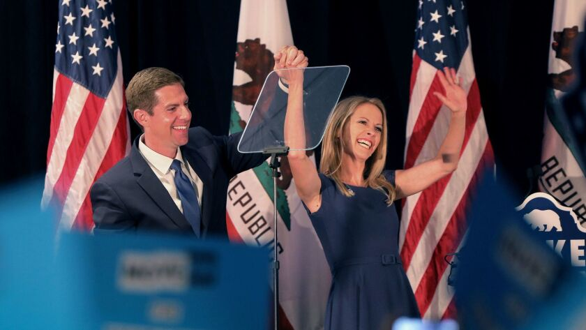 Congressional candidate Mike Levin and wife Chrissy greet supporters at the Hilton Hotel in Del Mar, on election night.