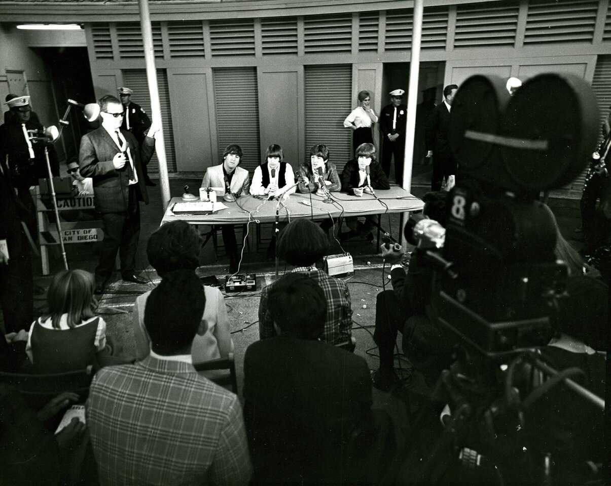 : Beatles press conference in San Diego at Balboa Stadium. L-R: John, Ringo, Paul and George August 28, 1965.