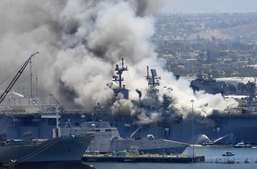 In this July 12, 2020, file photo, smoke rises from the USS Bonhomme Richard at Naval Base San Diego in San Diego.