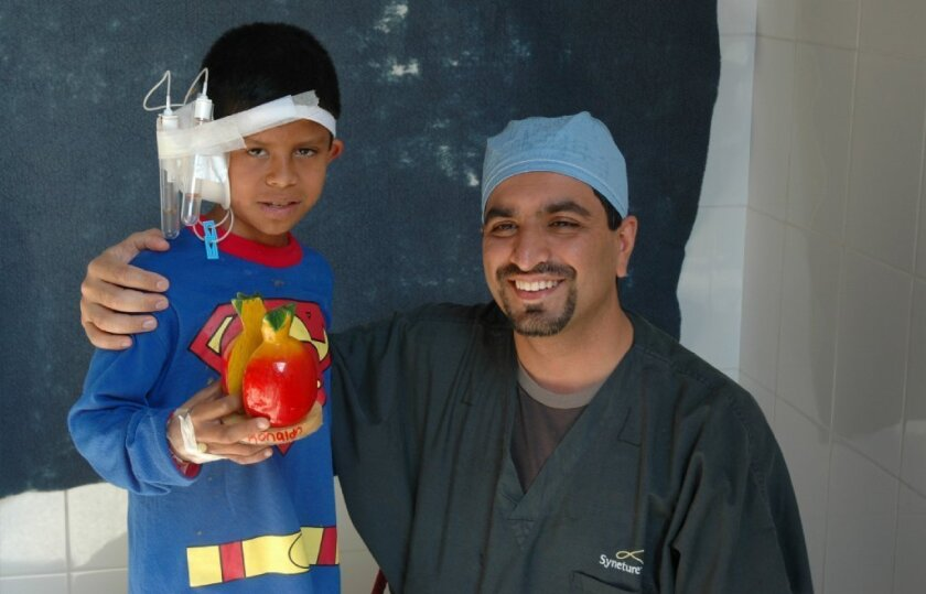 Dr. Ritvik Mehta with one of the microtia patients he has treated in Guatemala. / courtesy photo