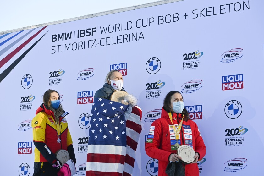 The podium with second placed Laura Nolte of Germany, winner Kaillie Humphries of USA and third placed Martina Fontanive of Switzerland, from left, after the women's monobob World Series in St. Moritz, Switzerland, on Saturday, January 16, 2021. (Gian Ehrenzeller/Keystone via AP)