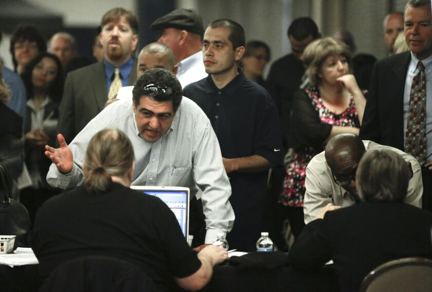 A report released Tuesday says FBI criminal background checks are often inaccurate and hurt job prospects for hundred of thousands. Above, a job fair in Anaheim in March.