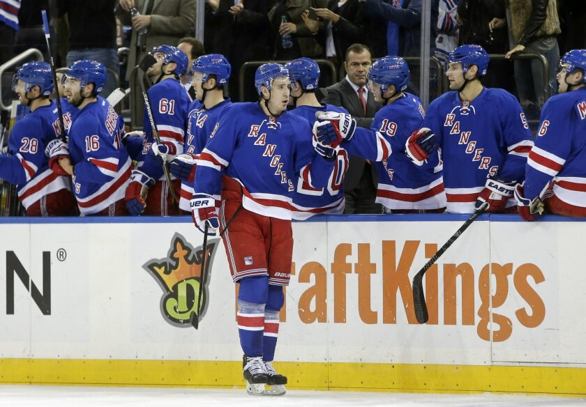 New York Rangers' Kevin Hayes (13) celebrates with teammates after scoring a goal during the first period of an NHL hockey game against the Washington Capitals Tuesday, Nov. 3, 2015, in New York. (AP Photo/Frank Franklin II)
