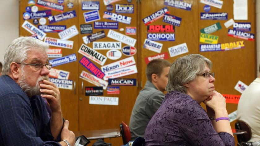 Iowa residents take part in a Republican caucus in Burlington in 2012.