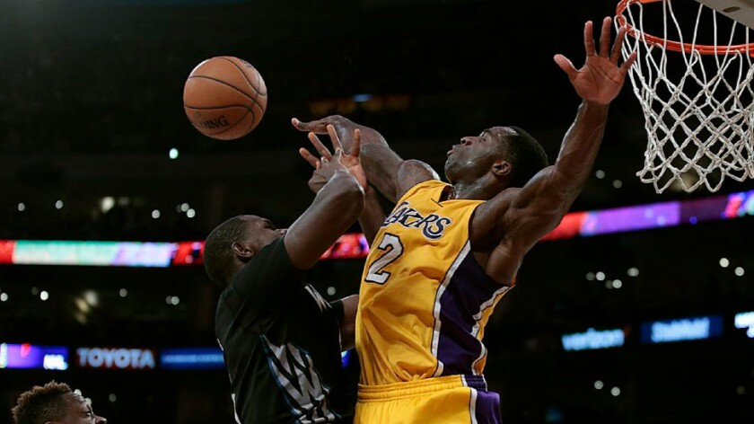 Lakers forward Brandon Bass gets called for a foul on Minnesota forward Gorgui Dieng during a game on Feb. 2.