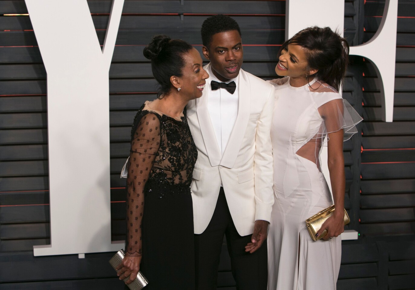 Oscars host Chris Rock poses with his wife, Malaak Compton Rock, right, and his mother, Rosalie Rock.