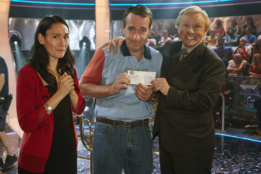 "Sian Clifford, left, as Diana Ingram, Matthew Macfadyen as Charles Ingram and Michael Sheen as Chris Tarrant in ""Quiz"" on AMC."