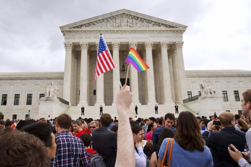 Supporters of a Supreme Court decision legalizing same-sex marriage nationwide celebrate in Washington on June 26.