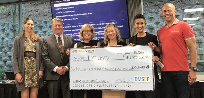 Del Mar Union School District board members Katherine Fitzpatrick and Doug Rafner, Superintendent Holly McClurg, board President Erica Halpern, Del Mar Schools Education Foundation President Samantha Madhosingh and foundation director Charles Patton. The foundation donated $1.37 million to the district.