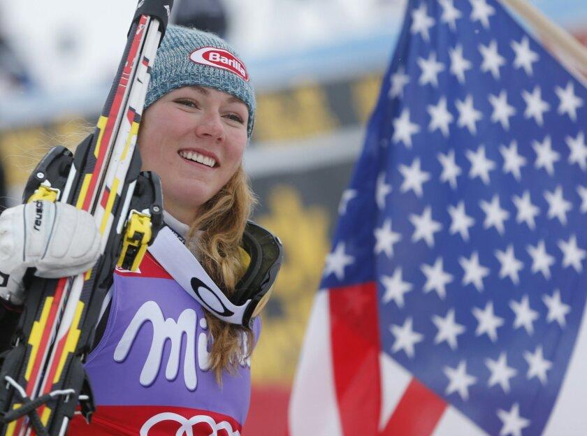 Mikaela Shiffrin, of the United States, celebrates after winning an alpine ski, women's World Cup slalom, in Bormio, Italy, Sunday, Jan. 5, 2013. (AP Photo/Marco Trovati)