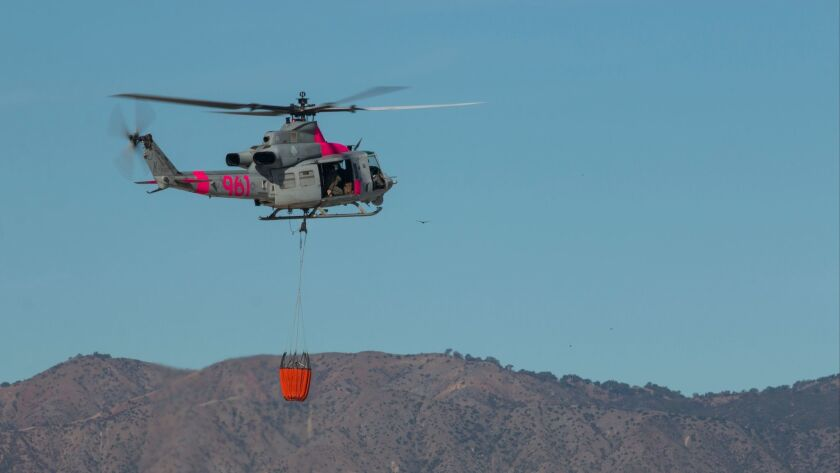 Navy, Marines deploy firefighting helicopters near Camp