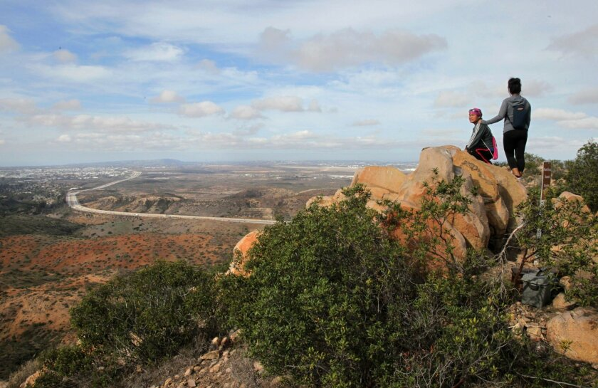 Rachel Quilapio, left, and friend Lea Talens enjoy the view west from the top of North Fortuna Peak in Mission Trails Regional Park.