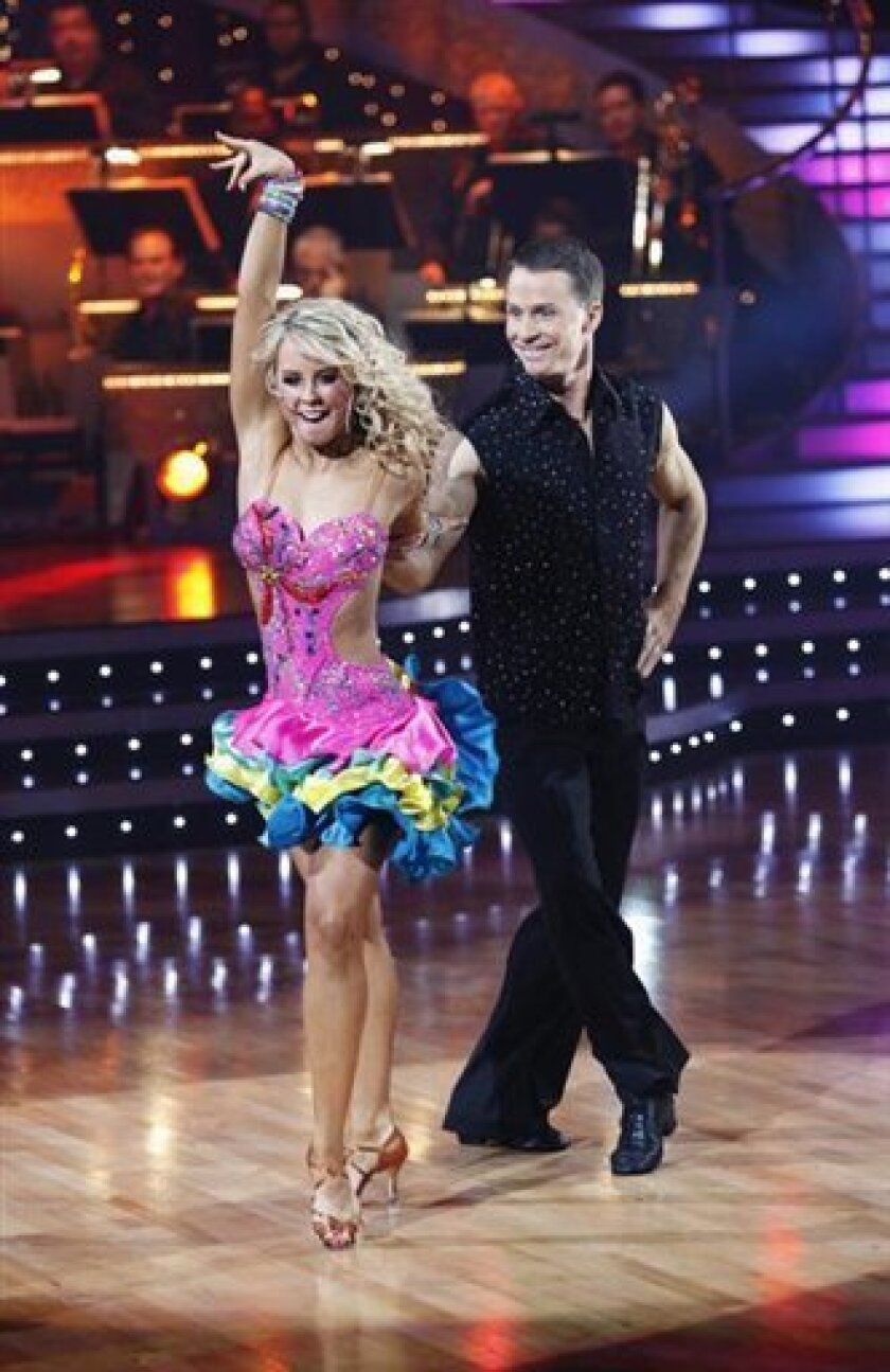 """This photo released by ABC shows Ty Murray, right, and Chelsie Hightower performing on """"Dancing with the Stars,"""" on Monday, May, 11, 2009 in Los Angeles. (AP Photo/ABC, Kelsey McNeal)"""
