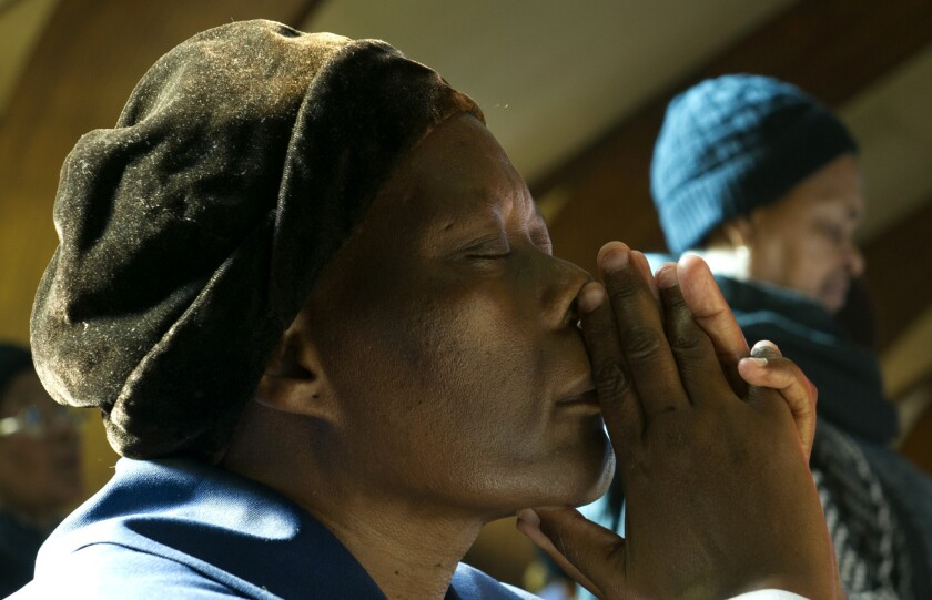 South Africans pray as Nelson Mandela battles lung infection