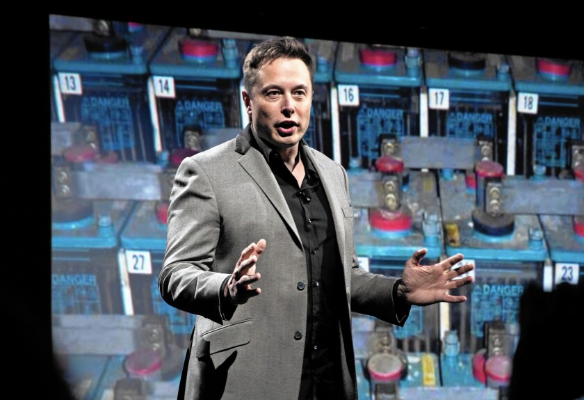 The Irvine Co. plans to install battery-powered energy systems that would use batteries purchased from Elon Musk's Tesla. Above, Musk unveils a new line of residential and commerical batteries in April.
