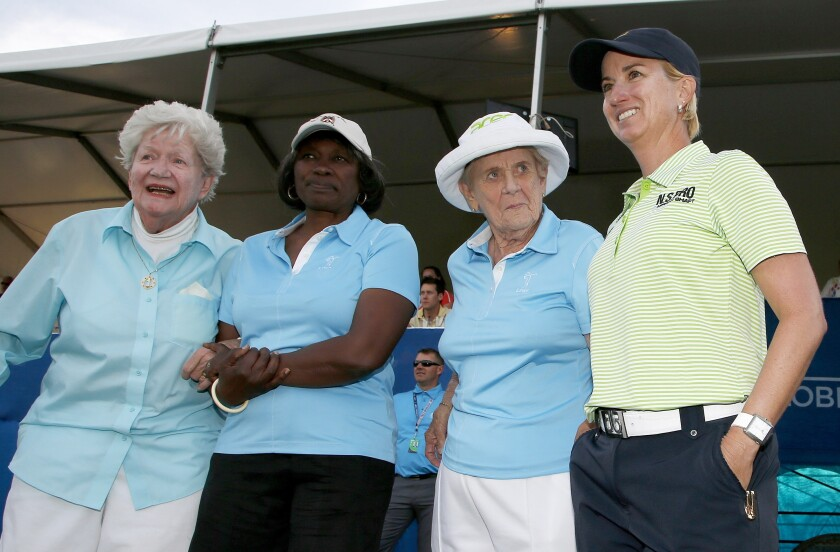 """FILE - Karrie Webb, right, of Australia, poses with LPGA Founder Marilynn Smith, left, LPGA """"Pioneer"""" Renee Powell, second from left, and LPGA Founder Shirley Spork, second from right, as Webb arrives for ceremonies after winning the LPGA Founders Cup golf tournament in Phoenix, in this Sunday, March 23, 2014, file photo. The tournament now is sponsored by New Jersey-based Cognizant, which chose to invest in men's and women's golf. (AP Photo/Ross D. Franklin, File)"""