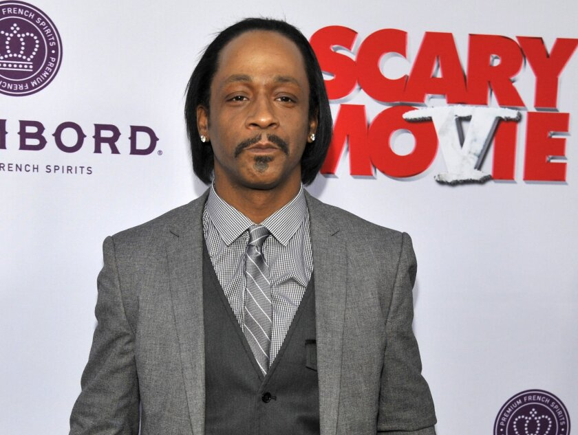 """FILE - In this April 11, 2013 file photo, Katt Williams, a cast member in """"Scary Movie V,"""" poses at the Los Angeles premiere of the film at the Cinerama Dome, in Los Angeles. Williams and a teenager have each been charged with disorderly conduct after fighting each other at an apartment complex, police in metro Atlanta said Monday, March 28, 2016. Williams, 44, and Luke Wash, 17, were both charged in connection with the fight last week, Gainesville Police Sgt. Kevin Holbrook said Monday. (Photo by Chris Pizzello/Invision/AP, File)"""
