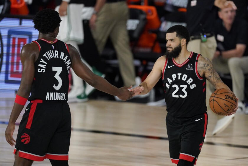 The Raptors' Fred VanVleet (23) celebrates with teammate OG Anunoby during Toronto's win over Boston on Sept. 5, 2020.