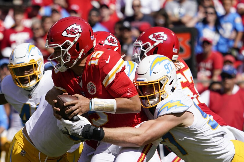 Chiefs' Patrick Mahomes (15) is sacked by  Chargers' Joey Bosa.