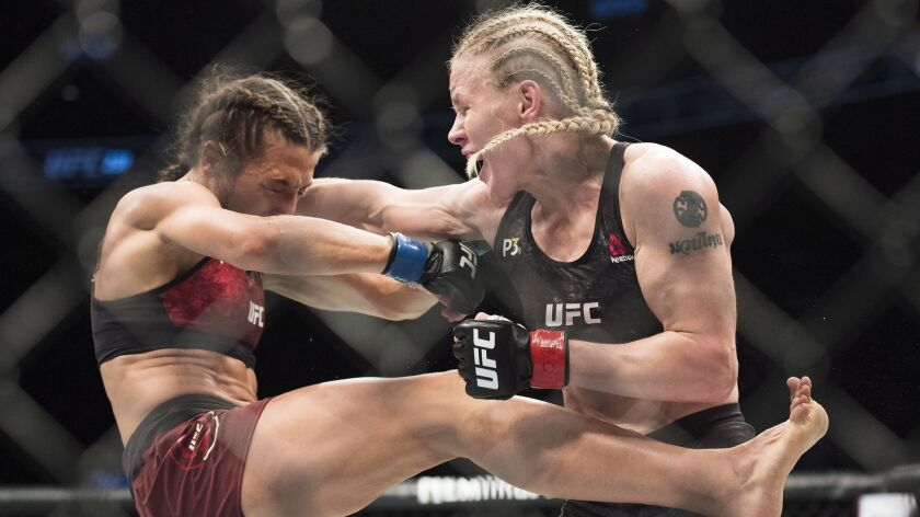 Valentina Shevchenko, right, fights Joanna Jedrzejczyk during the a women's flyweight mixed martial