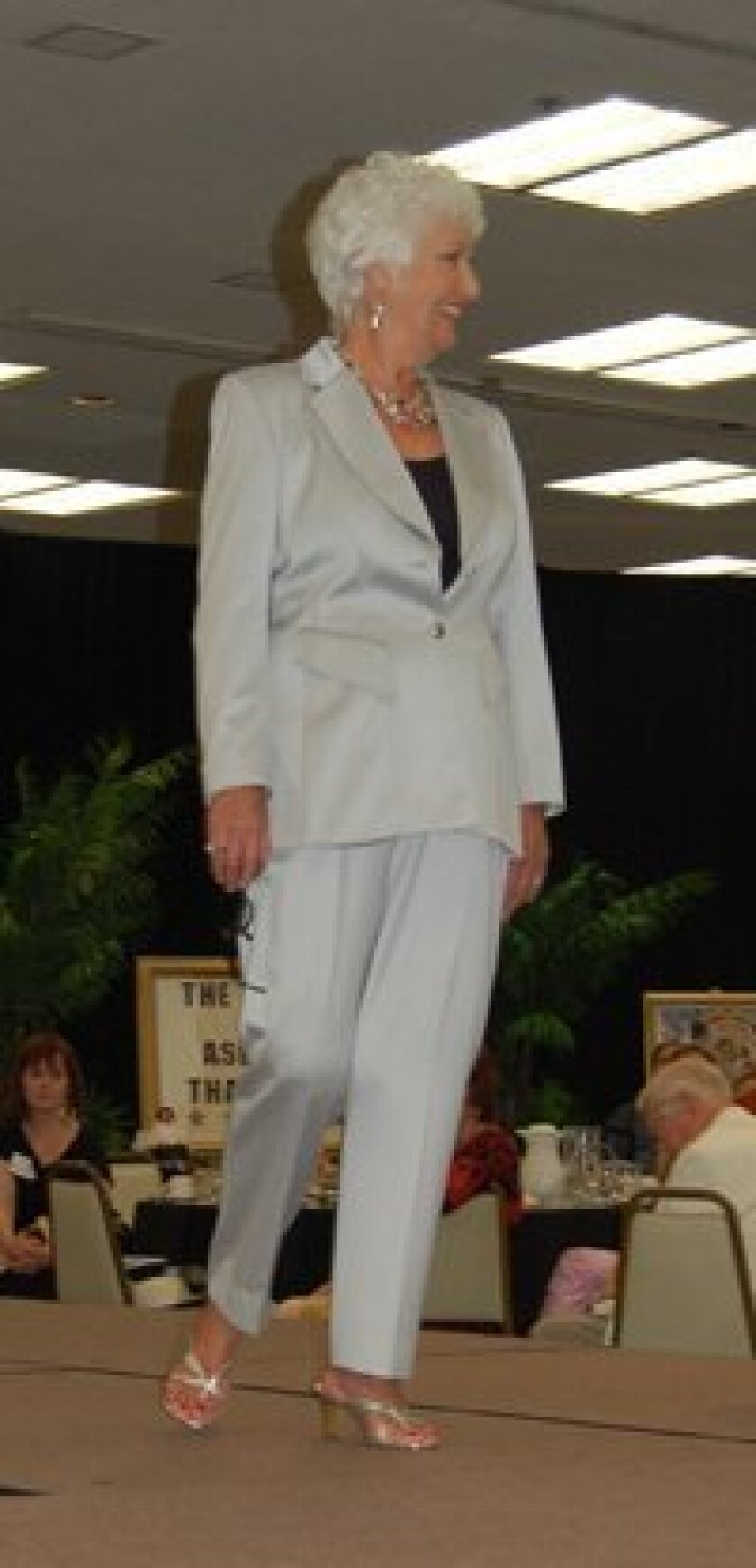Jean Boyd in an Escada pants suit donate by the Mabee family.