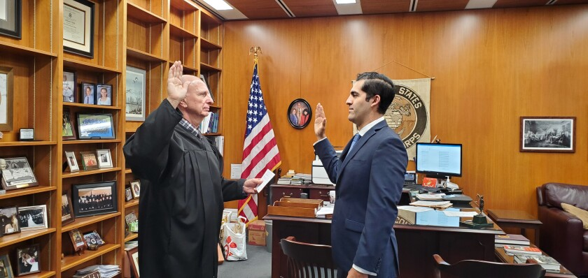 Noel Meza was sworn-in by Judge William Gallo.