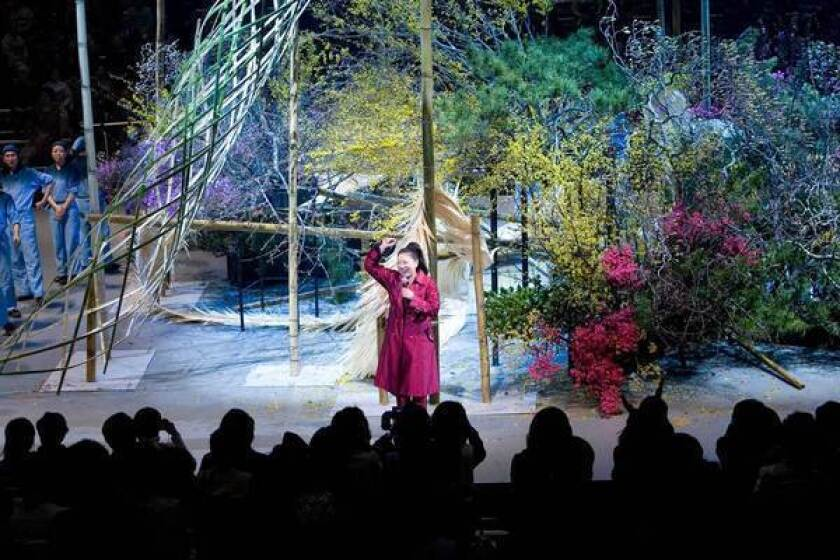 """Akane Teshigahara receives an ovation during a previous year's """"Iemoto Ikebana Live"""" performance, during which the ikebana master uses an entire stage as her vase. For the first time, the production -- large enough to require a supporting cast of assistants -- will be staged in Los Angeles."""