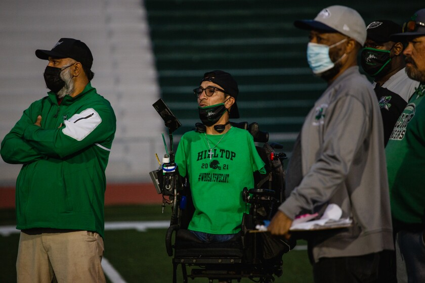 Rob Mendez along with fellow Hilltop High School coaches watch the junior varsity team practice.