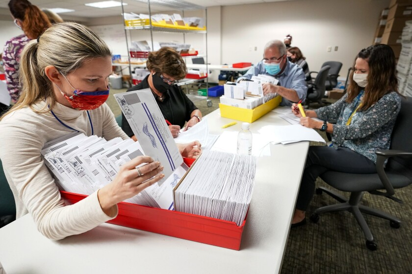 Lehigh County workers count ballots on Thursday, Nov. 5, 2020, in Allentown, Pa.
