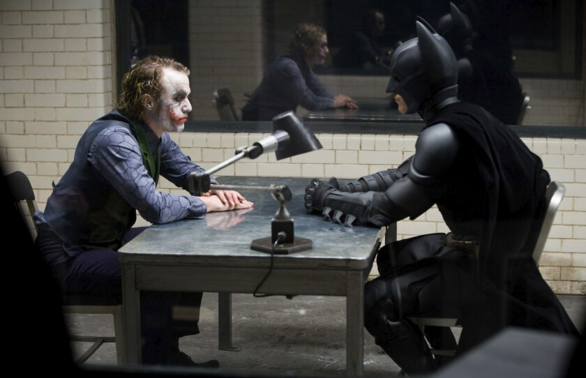"""This image released by the Library of Congress shows Heath Ledger, left, and Christian Bale in a scene from the 2008 film """"The Dark Knight."""" The film was added to the National Film Registry. (Warner Bros.-Library of Congress via AP)"""