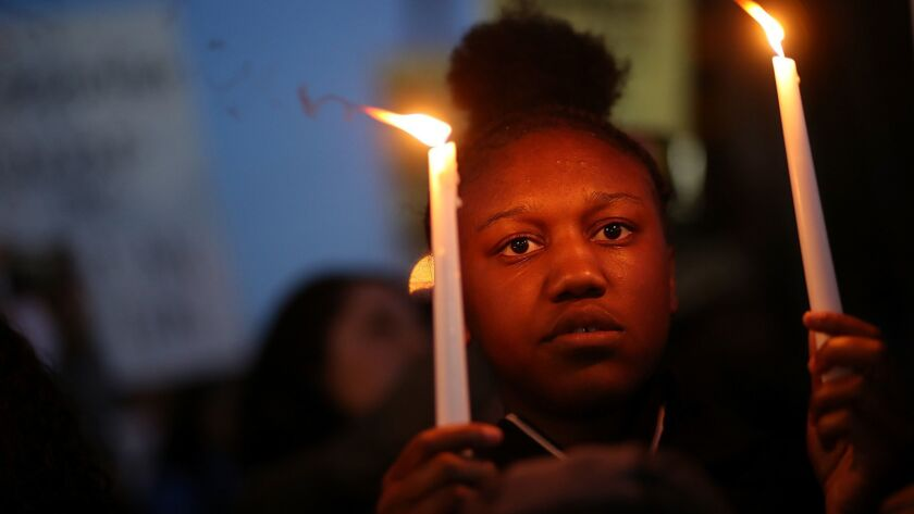 A Black Lives Matter protester attends a vigil in Sacramento for police shooting victim Stephon Clark.