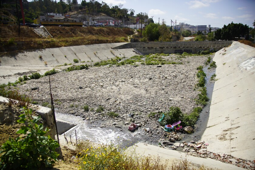 Trash and sewage flow into a storm drain in Tijuana.