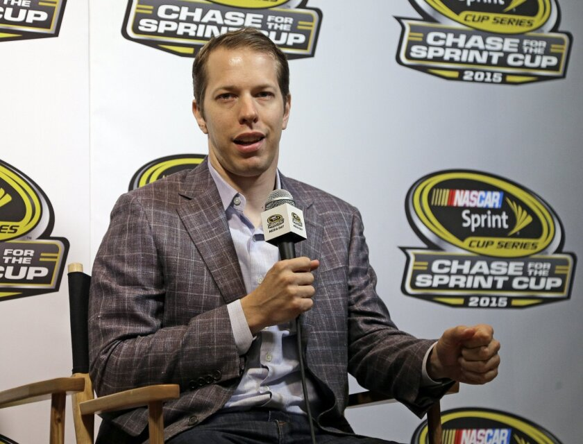 Driver Brad Keselowski talks to the media during the NASCAR Sprint Cup series auto racing Eliminator Media Day in Charlotte, N.C., Tuesday, Oct. 27, 2015. (AP Photo/Chuck Burton)