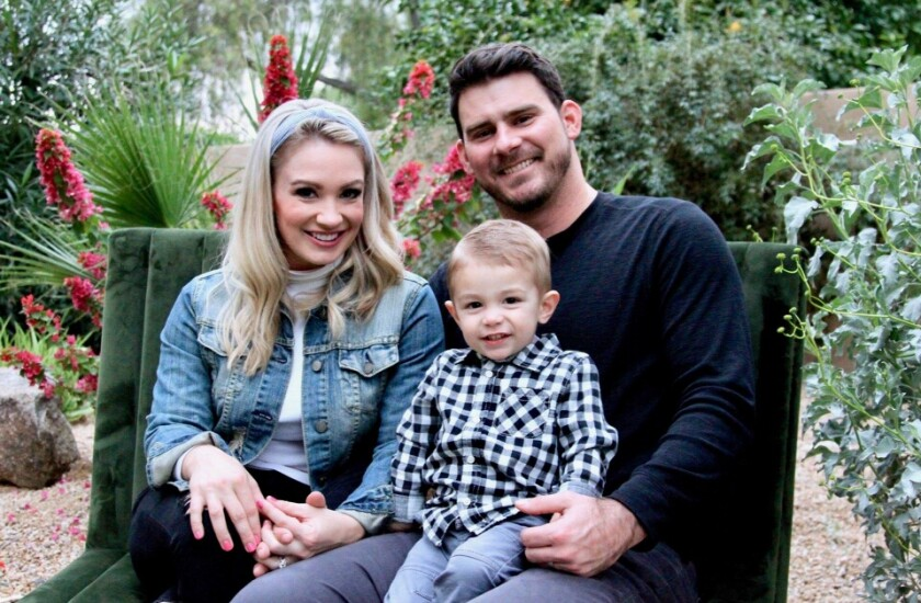 Former Angels prospect Brandon Wood and his wife Elly sit with their 2-year-old son Brooks in early 2020.